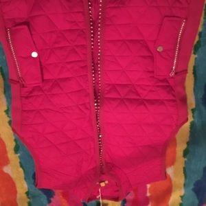 magenta vest with rhinestone embellishments